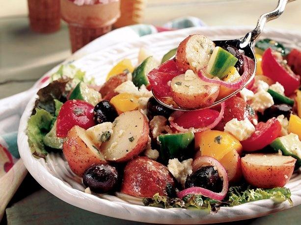 Greek Potato Salad.Olives, feta, tomatoes and a garlicy, lemon-Dijon dressing turn potato salad into a great Greek salad.