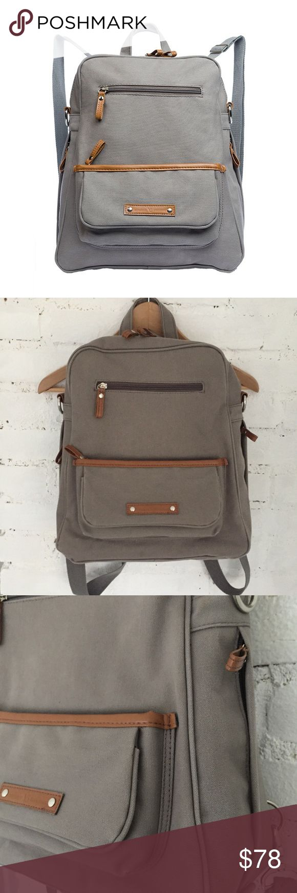 """Canvas Backpack Neutral backpack!!  This does not have to be a diaper bag. I bought it for my laptop but it's too small.  This is better for smaller laptops 💻  This is the Vilah Bloom """"Monroe-On-the-Go"""" Diaper Bag ⚪️ Windy City gray color ⚪️ """"heavy duty canvas that is reinforced with matte foil for extra water protection! ...ability to change from backpack to crossbody and the built in wipe dispenser"""" — info from Bump Box website ⚪️ EUC, tiny spot on backside ⚪️ Vegan leather trim ⚪️ 12"""" L…"""