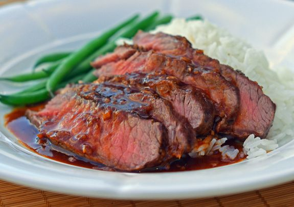 Flat iron steak is one of my favorite cuts of beef for home cooking. It's similar to flank or skirt steak, only much more tender — in fact, after the tenderloin, it's the second most tender cut. Plus, it's cheap. Here, I've broiled it and topped it with a rich Asian-style brown sauce. With buttered rice and …