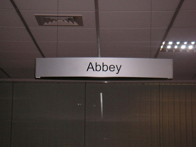 suspended sign brushed steel by Opening the Book, via Flickr