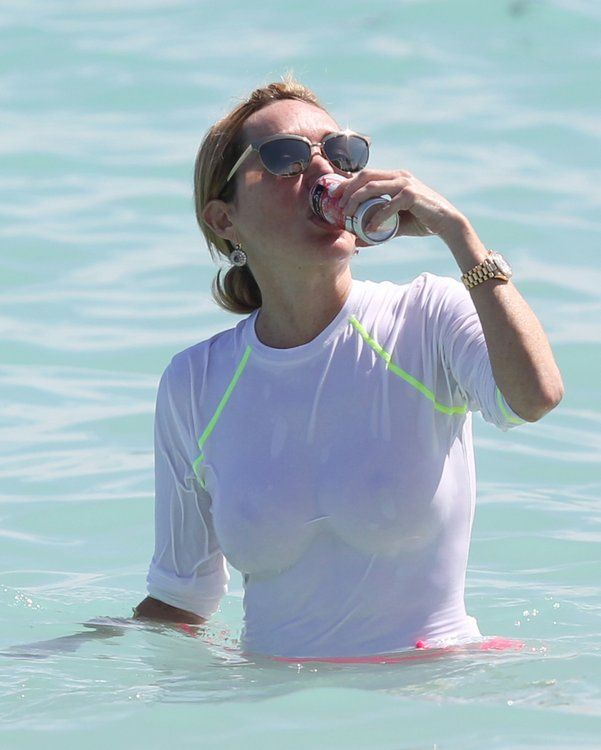 Real Housewives of Miami's Marysol Patton Braless In The Ocean To Promote New Product?