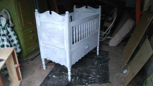 Baby cot project. Primer coat finished,still deciding on the final overall finish