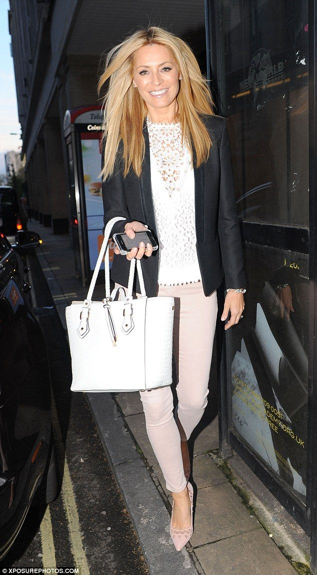 Beaming: Tess Daly was in great spirits as she hit the shops on Oxford Street in London on...