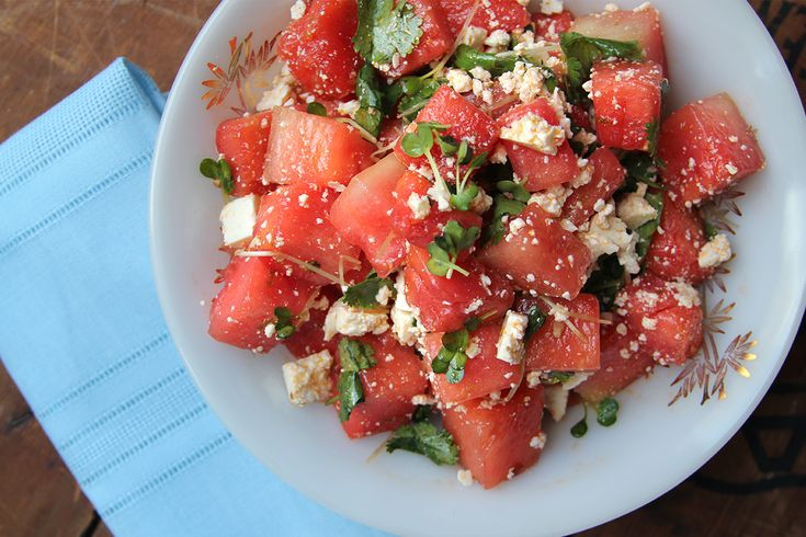 Watermelon Salad with Cilantro, Radish Sprouts, and Cotija Recipe by saveur: Watermelon at the peak of its sweetness is tossed in a zesty vinaigrette with spicy radish sprouts. #Salad #Watermelon #Cojita
