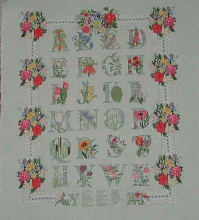 """Questo è un kit di """"Le bonheur des dames"""", comprato a Parigi, per ricordare le nostre vacanze.  Misura 71 x 54 cm. Iniziato più o meno a Pasqua e finito di ricamare a punto croce e punto scritto su Etamine di cotone  a Natale del 2001"""