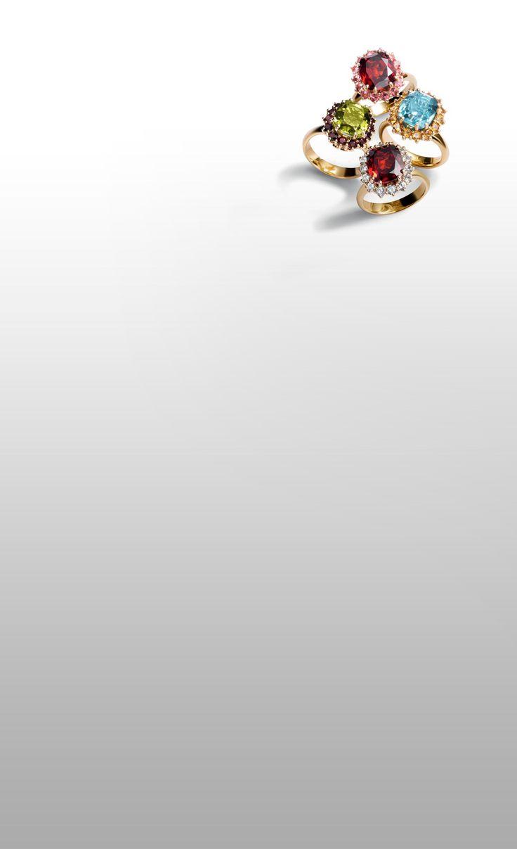 dolce and gabbana jewellery gold rings red garnet aquamarine green peridot pink tourmaline sapphires diamonds slider