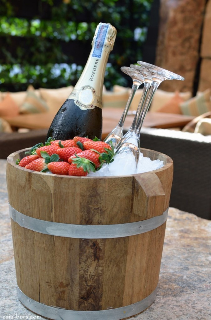 Loius Roederer Champagne- at ZUMA Bangkok all champagne bottles served in wooden ice bucket with chilled glasses and strawberries.  http://www.asia-bars.com/2011/12/zuma-bangkok-globally-acclaimed-restaurant-group-opens-superlative-venue-in-thailand/