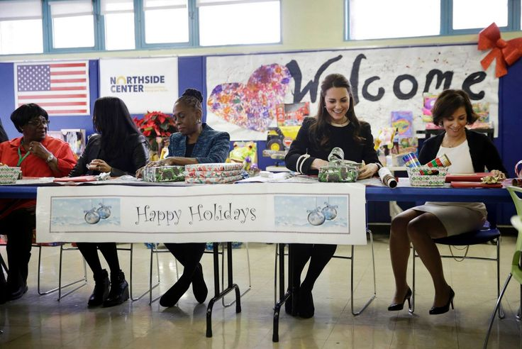 Britain's Catherine, Duchess of Cambridge wraps presents for children with Chirlane McCray, the wife of the mayor of New York City (C) and other volunteers at the Northside Center for Childhood Development in New York, December 8, 2014.