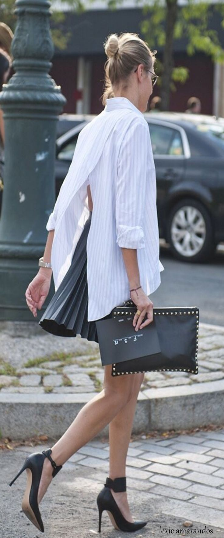 Oversized pinstripe mans shirt with open back and pinch pleat short skirt and heels so cute.