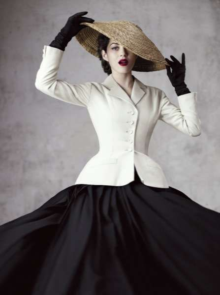 Marion Cotillard in Dior. Love the tailored coat over the big skirt!