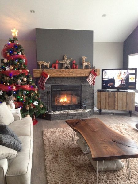 We not only made this barn beam fireplace mantel but the walnut live edge coffee table. We love our clients! (Christmas Mantle Table Centerpieces)