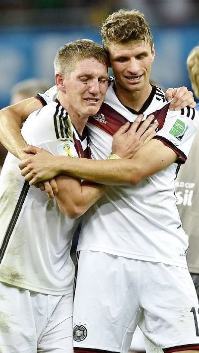 Thomas Müller & Bastian Schweinsteiger (after World Cup win)