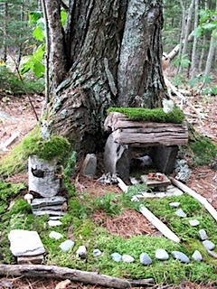 Teaching children to respect nature by building a fairy house.