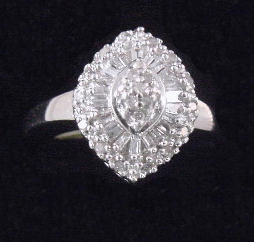 10 k White Gold Woman's .25 ct Diamond Ring With Baguette & Round Brilliant Cut