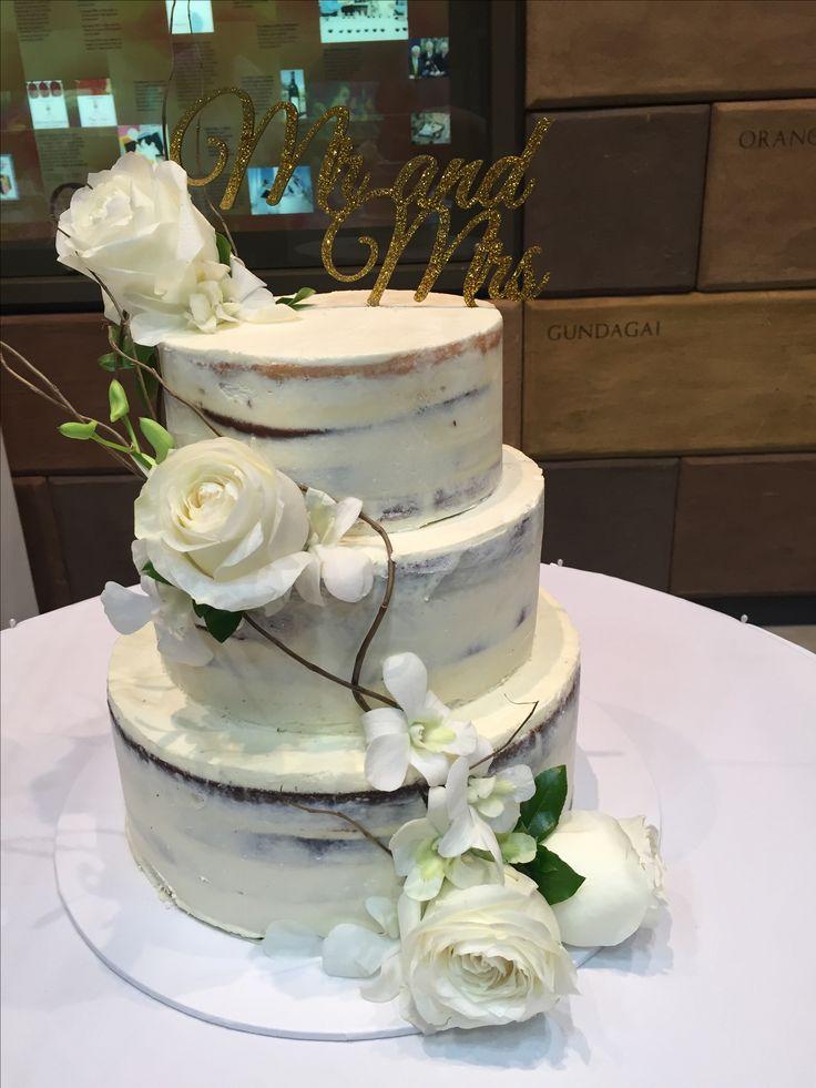 Semi naked three tier mudcake wedding cake
