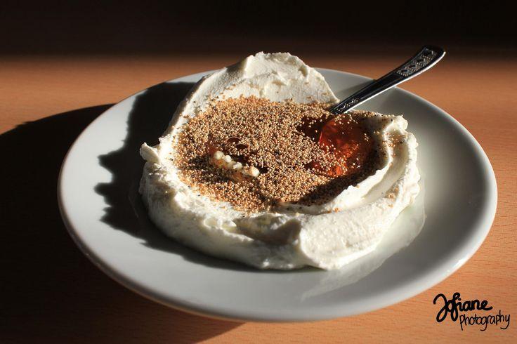 Turkish Yogurt: a plate of yogurt with honey and opium seeds
