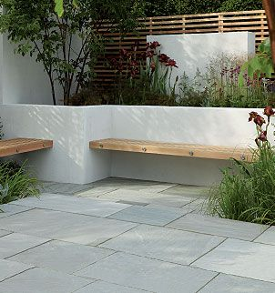 Contemporary Hardwood Benches Built Into A White Rendered, Walled Seating/ Patio Area Stonemarket: Garden Range: Natural Stone: Trustone Fellstyle