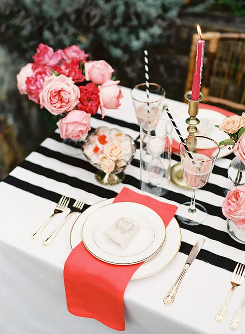 black and white stripes with pink flowers table setting