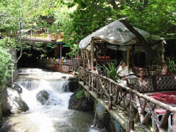 """Darband mountain resort near Tehran-Imagine sitting in the cool shadow under the huge lush trees, inhaling the fresh mountain air and the smoke of the hooka or in Persian """"Qalioon"""" (Water pipe) while sipping delicious Persian tea served straight from the samavar... That's Iran!"""