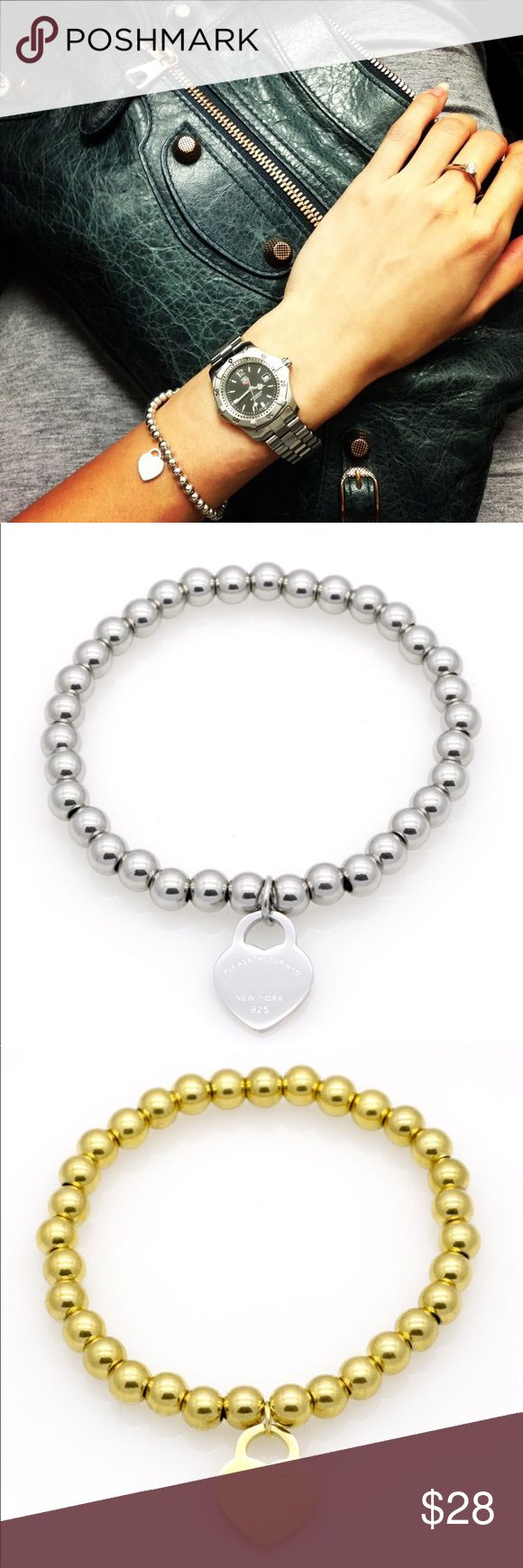 Tiffany Microfiche Heart Tag Bead Bracelet Designer Engraved Heart Bead Bracelet in silver & gold. Stretch for comfortable fit.   Inspired by the iconic key ring first introduced in 1969, the Return to collection is a classic reinvented. An elegant bead bracelet and engraved tag combine to create a simple and timeless design.  Lead, Nickel, & Cadmium free.  *NOTE: Remember to remove jewelry before direct contact with any water, lotions, and/or perfumes. It keeps the integrity of the jewelry…