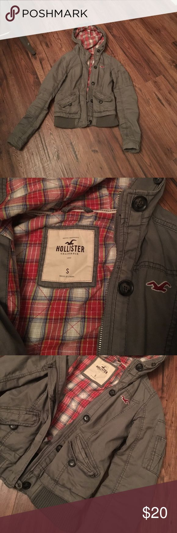 Like new Hollister coat This coat has a hood with removable fur band. It is a light army green color with a red plaid inside. It has two front pockets. All zippers and buttons work. Comes from a pet and smoke free home. Hollister Jackets & Coats
