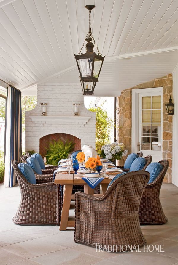 Summer Classics wicker dining chairs surround the outdoor dining table. - Photo: Michael Garland / Design: Catherine Miller
