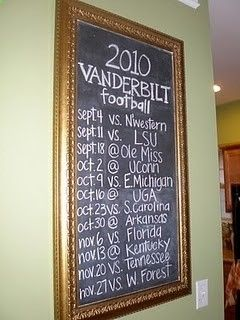 Football schedule displayed on the wall.