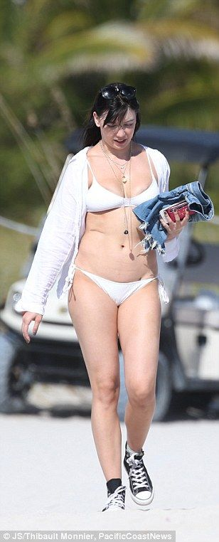 All white on the night:The 27-year-old model looked incredible as she flaunted her hourglass curves in a skimpy ivory bikini