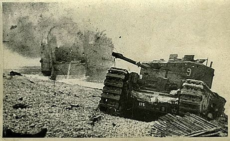 After the raid on Dieppe on August 19, 1942, B-Squadron Churchill, Blossom sits on the beach, its right track damaged by the smooth rocks built up in the wheels and track. Tank Landing Craft No. 5 burns in the background after being knocked out by heavy shellfire. (Rob Alexander collection)