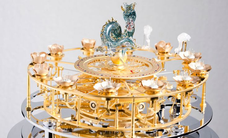 """Miki Eleta Flower Clock.  """"Somewhere in between the made-up worlds of Rube Goldberg and Roald Dahl there exists a place where the creations of Miki Eleta would seem at home. HERE, in THIS reality, in OUR world, Miki Eleta's kinetic sculptures look totally otherworldly and very special indeed."""""""