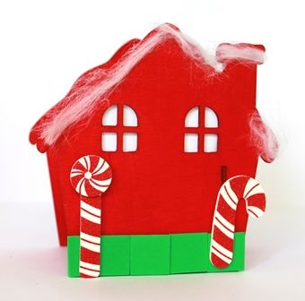 Build and decorate this Christmas house using our wooden click together house kit.