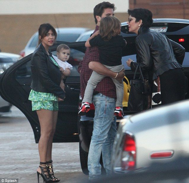 Affectionate group: Kourtney Kardashian, Penelope Disick and Mason Dash Disick joined by father Scott Disick and manager mother Kris Jenner