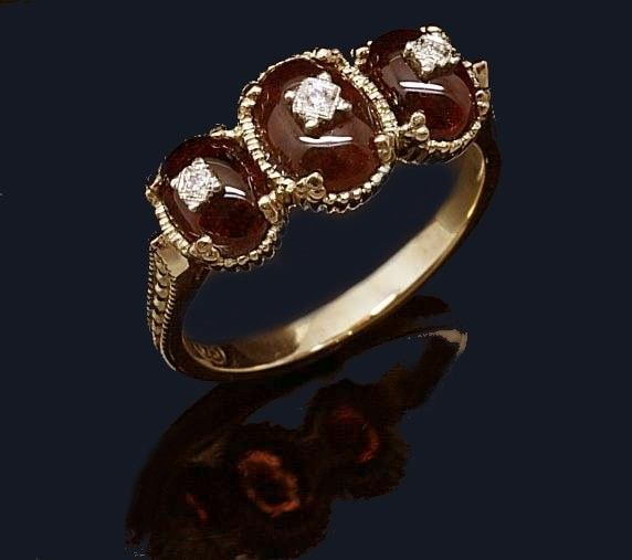 9ct. Yellow gold Garnet and Diamond Dress Ring.