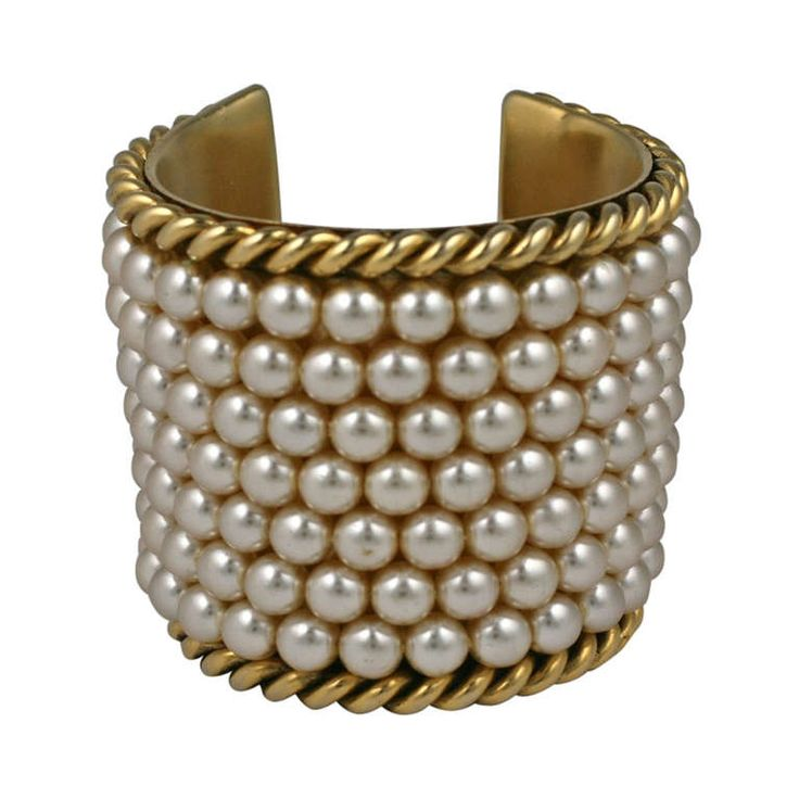 Iconic Chanel Pearl Cuff | From a unique collection of vintage cuff bracelets at https://www.1stdibs.com/jewelry/bracelets/cuff-bracelets/