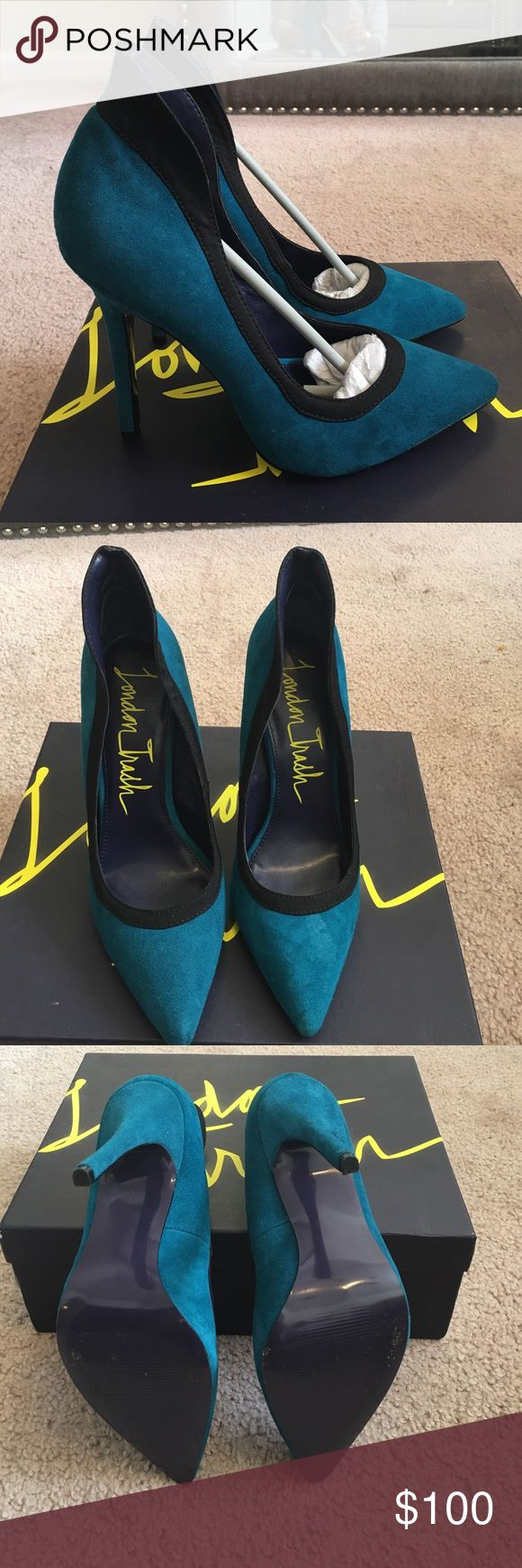 London Trash Shoes (pumps) London Trash pumps. I absolutely love these pumps but because I have narrow heels they don't stay on my feet good. I have only worn these twice (on carpeted area).  These pumps are definitely eye catching! London Trash Shoes Heels