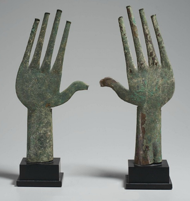 For a similar pair from the Tomb of the Bronze Chariot at Vulci, now in the Villa Giulia, Rome, see p. 125 in Torelli, ed., The Etruscans.
