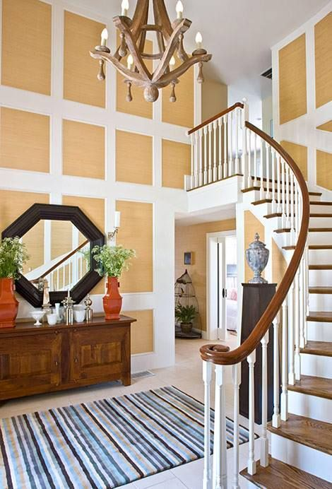 Traditional Foyer with a grid of grasscloth wall covering detail.