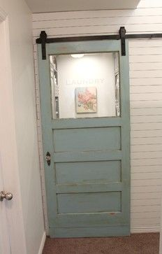 "Laundry Room entrance :: Antique door at rolling ""barn door"" hardware"