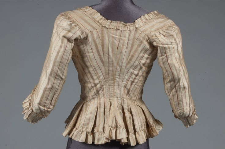 Rear view, caraco, 1770s. Ivory striped silk in gold and copper tones with fine red and lime lines, lined in apricot and green stripes silk with embroidered buttons.