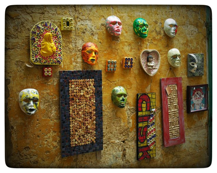 the outside wall of the gallery - ready for carnival - crazy masks and drink related art