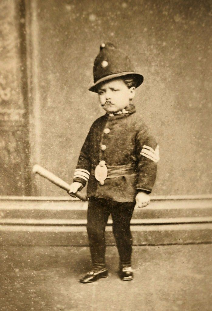 Toddler dressed as a Constable - Portrait taken by W. H. Moore & Son of Merchant Street, Bristol, England - late 1800s