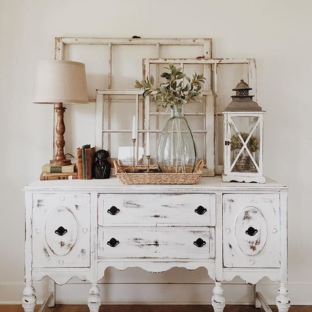 Shabby chic revival - old windows, choppy white paint, lanterns and simple florals.