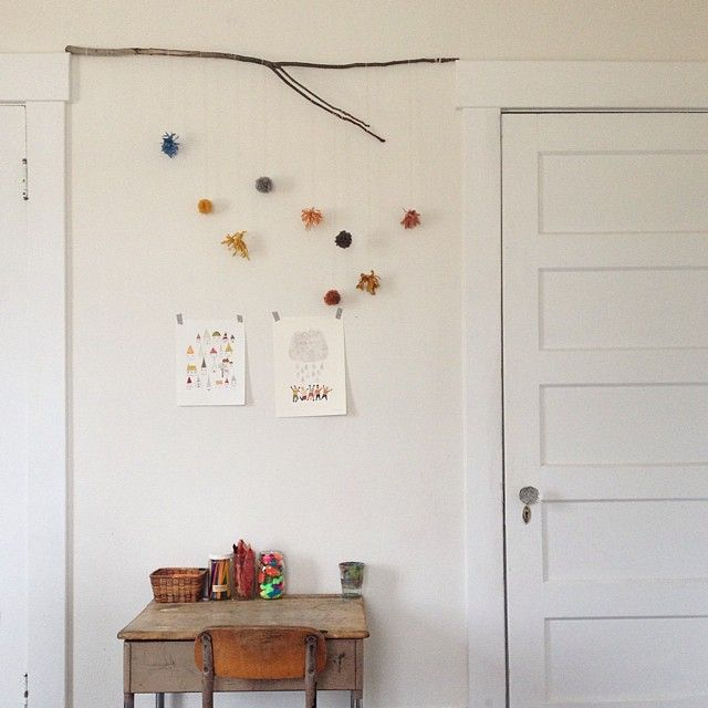 Lovely simple idea with stick suspended between the door frames to hang things from