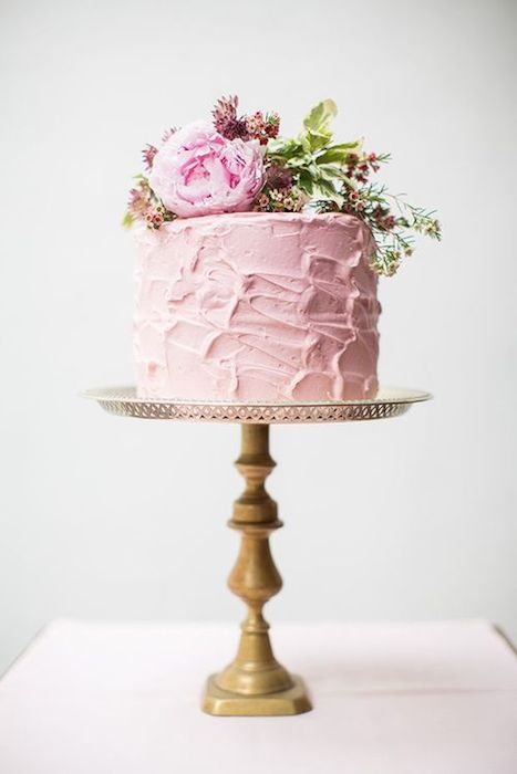 For an intimate wedding, a multi-tiered cake isn't always necessary. A single-layer cake can still be eye-catching and also a way to cut down on your budget