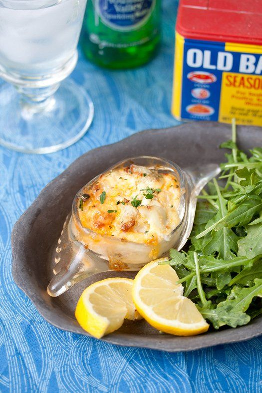 Crab Imperial   1/2 lb fresh lump crab meat 2 oz cream cheese, softened 2 Tbsp mayonnaise 1 Tbsp heavy cream 1 egg, beaten juice of 1/2 lemon 1/2 tsp Old Bay seafood seasoning 1/3 cup Cheddar cheese, shredded fresh parsley, for garnish Preheat oven to 350 degrees. Combine cream cheese, mayonnaise, heavy cream, and egg. Carefully mix unt