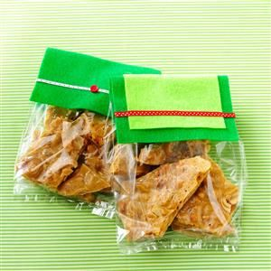 Maple-Spice Cashew Brittle Recipe -Crunchy cashews dot this tasty golden brittle, and a hint of spice makes it delightfully different. —Annie Rundle, Simple & Delicious Test Kitchen
