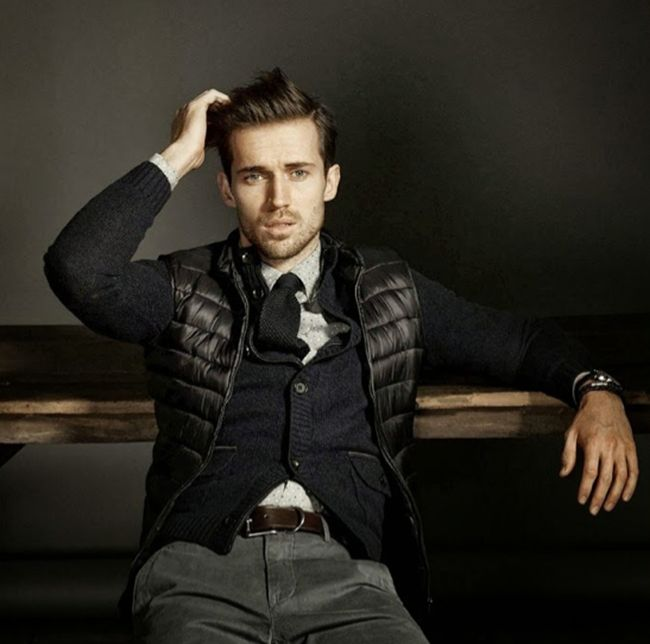 A cardigan/waist coat combination. Looks really good with the tie. Model: Andrew Cooper.