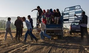 Syrian children refugees jump out of the truck that takes them to work at a farm in Lebanon's Bekaa valley.