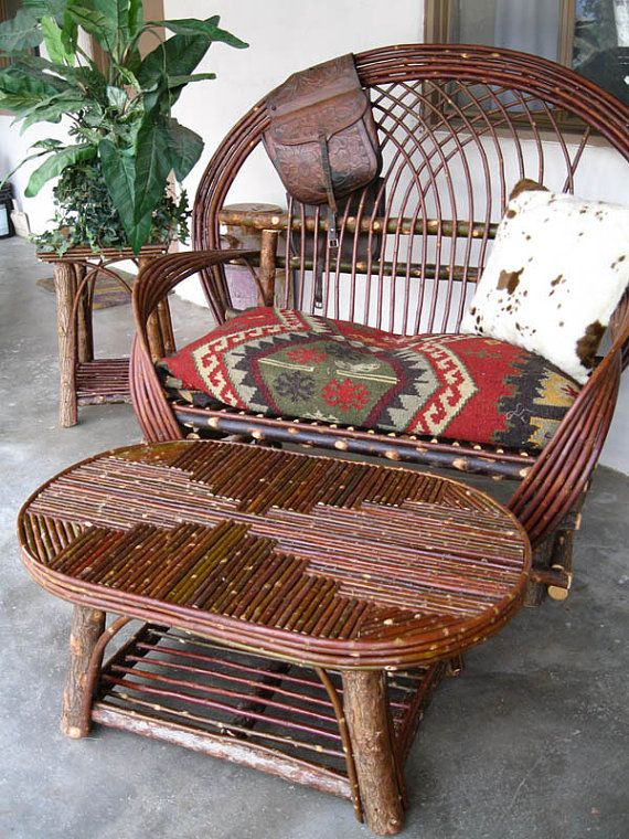 Willow chair with twig mosaic table. I think I could do a table like this. Hmmm...very far future project!