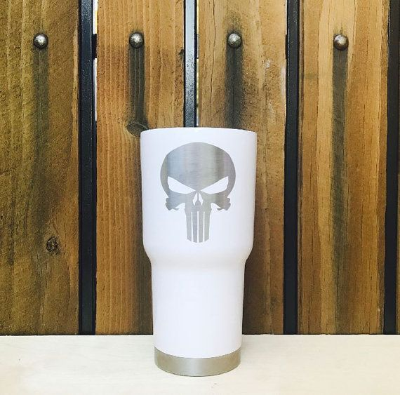 White Laser etched Punisher Skull Marvel Comics RTIC Tumbler  We promise all your friends will be asking you where got that awesome tumbler.  Why get a laser etch tumbler over a screen printed one? We custom laser etch each tumbler with a special chemical that burns the design permanently in black. This means you can wash it over and over and the logo will NEVER rub off. Screen printing can fade and chip off over time. Laser etching will be there for life!  About RTIC Tumblers: RTIC…